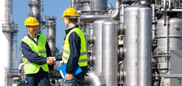 Shaking hands at refinery.jpg
