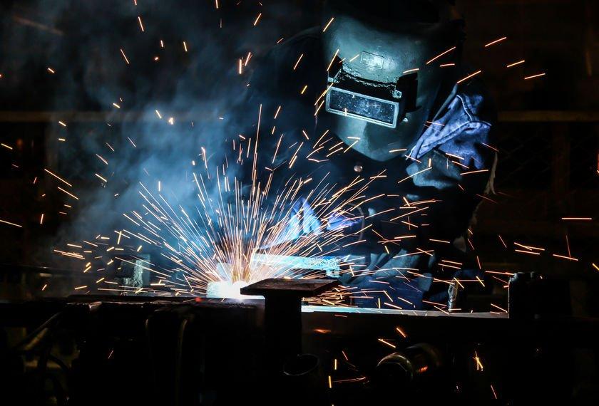 people welding industry