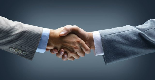 handshake_-_hand_holding_on_black_background.jpg