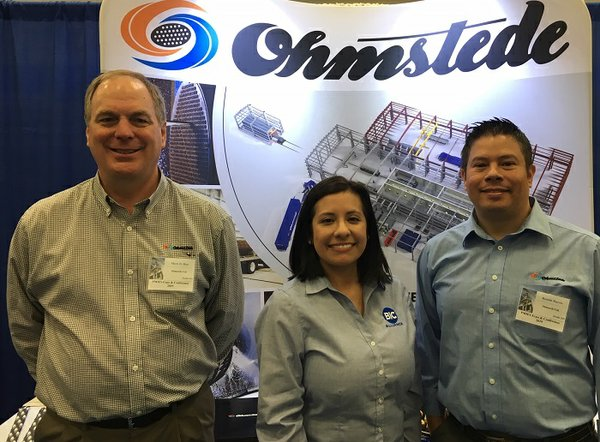 Mark Biar of Ohmstede welcomes Leslie Ordonez of BIC Magazine and Ronnie Harris of Ohmstede at PMIES Expo