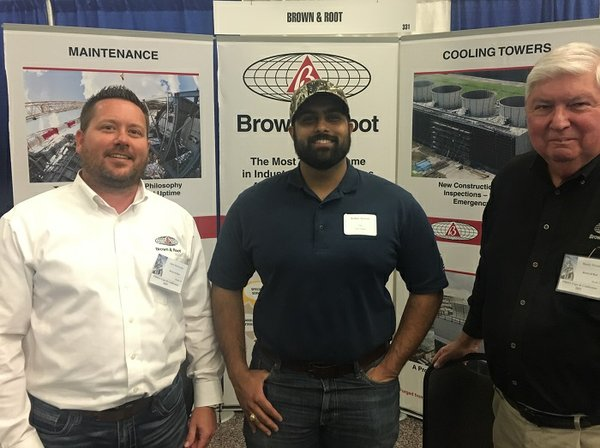 Occidental Petroleum visits Brown & Root's booth at the PMIES Expo