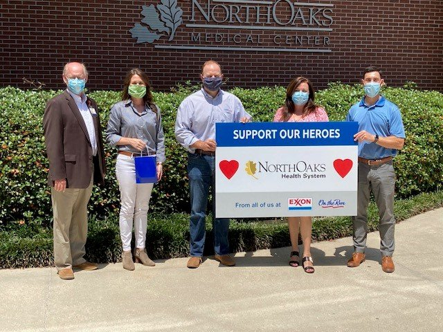 Employees at Lard Oil donate gift cards to healthcare workers at North Oaks Hospital in Hammond.