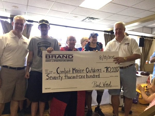 Brand golf tourney Combat Marine Outdoors check.JPG