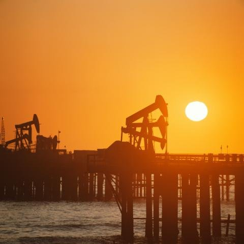 Drilling rigs at sunset.JPG