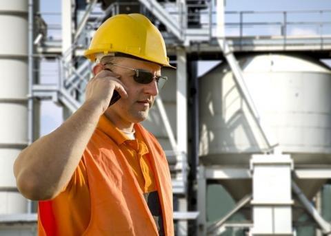 Refinery worker on phone.jpg