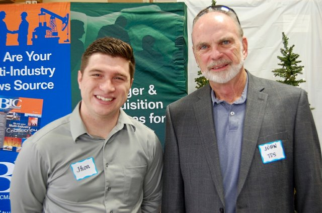 BIC Alliance and TDS share a photo at the BIC Christmas Open House